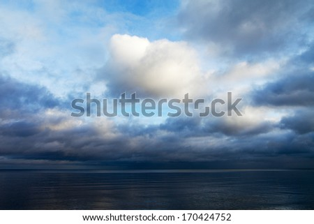 Cold clouds over Baltic sea. - stock photo
