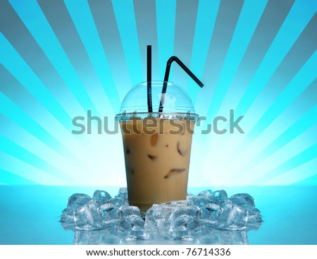 Cold coffee drink on abstract blue background - stock photo