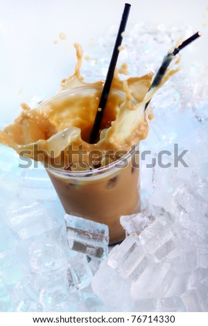 Cold coffee drink wwith ice and splashes - stock photo