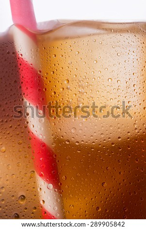 cold cola with straw and ice cubes background texture - stock photo