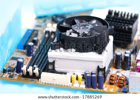 cold cpu and motherboard - stock photo