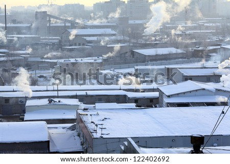 cold day in the city, the smoke from the chimneys, global cooling - stock photo