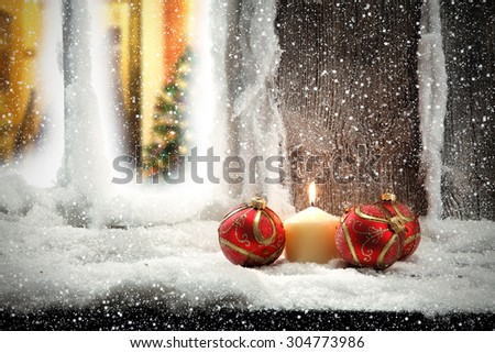 cold day window sill and red balls  - stock photo