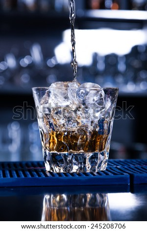 Cold drink on the bar counter - stock photo