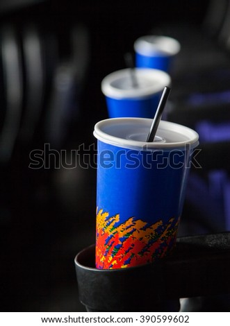 Cold Drinks In Armrests At Theater