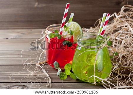 Cold drinks in Mason jar on a wooden background - stock photo