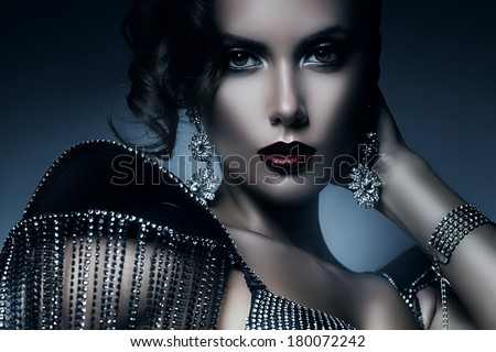 cold elegant woman in accessories of stones - stock photo