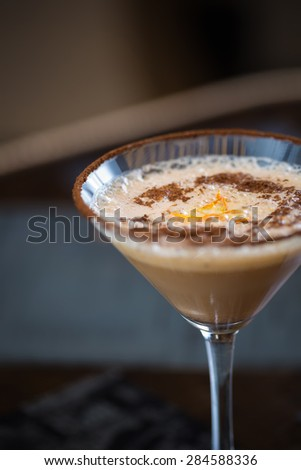 Cold fresh cocktail coffee with orange. Shallow dof - stock photo