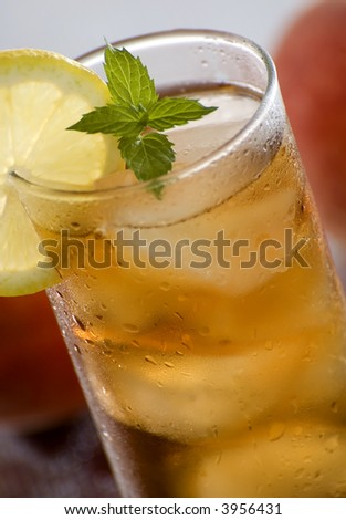cold fresh ice tea with lemon close up shoot - stock photo
