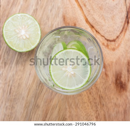 Cold fresh lemonade with lemon on top view. - stock photo