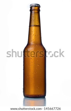 Cold frosted beer bottle on white background.