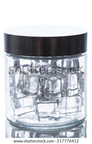 Cold. Frozen ice cubes in a jar - stock photo