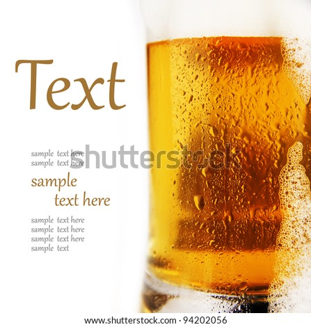 cold glass of beer with foam  (With sample text) - stock photo