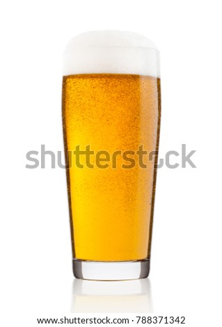 Cold glass of lager beer with foam and dew isolated on white background