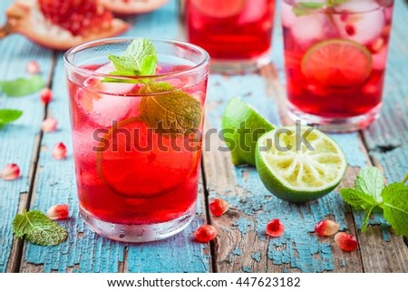 cold homemade lemonade with pomegranate, mint and lime - stock photo