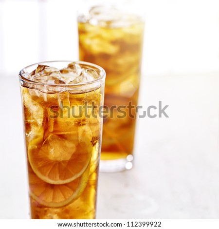 cold iced tea with sliced lemons. - stock photo