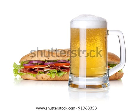 Cold lager beer glass and long sandwich. Isolated on white background - stock photo