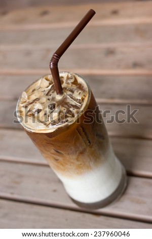 cold late coffee drink with ice on table. - stock photo