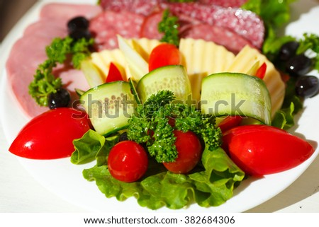 cold meats cheese fresh vegetables cucumber greens tomato