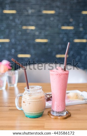 Cold milk pink smoothie and milk tea on a wooden table - stock photo