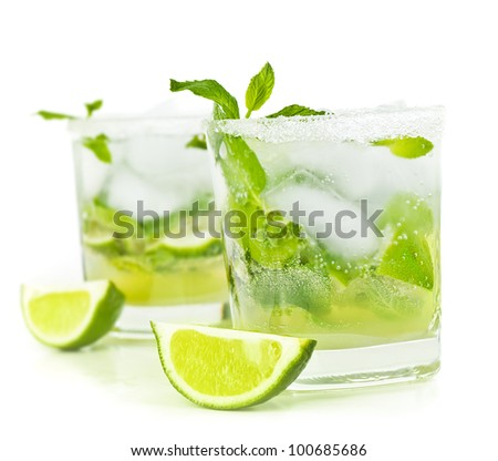 Cold mojito drink, glass of alcohol isolated over white background, fresh mint and lime fruit slice, food still life, party and holidays celebration - stock photo