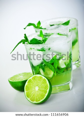 Cold mojito drink, glass of icy alcohol refreshing booze, tasty Cuban alcoholic cocktail made of fresh mint leaves and lime fruit, food and beverage still life, party and holidays celebration - stock photo