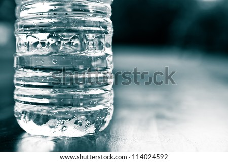 Cold plastic bottle of water. drought, thirst, hydration, natural resource conservation and recycling concept. - stock photo