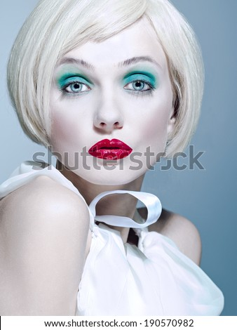 cold portrait of the blonde with red lips