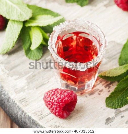 Cold Raspberry cocktail with mint, selective focus and square image - stock photo