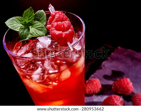 Cold red drink  with berry and green mint leaf. Top view. - stock photo