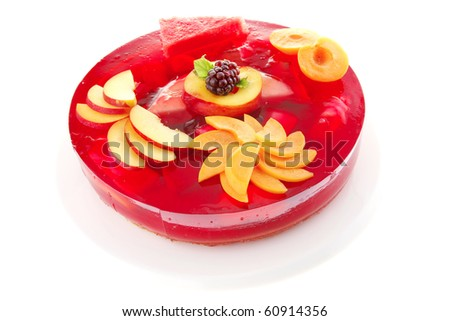 cold red jelly cake with peach and nectarine
