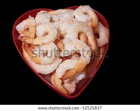 Cold shrimp inside a heart shaped bowl - stock photo