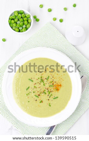 cold soup of green peas with yogurt and chives top view vertical