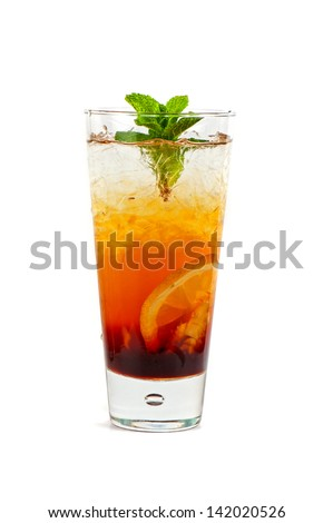 cold tea with grapefruit, lime, mint and ice on white - stock photo