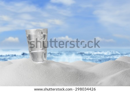 Cold Water Drink on Sandy Beach - stock photo