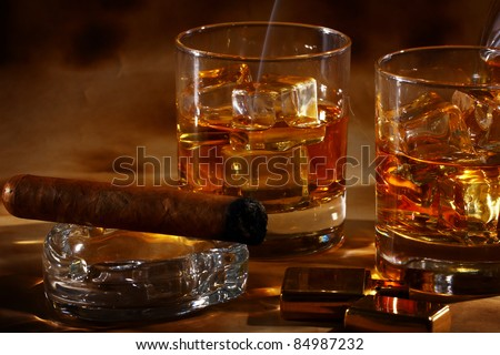 Cold Whiskey Cigar Against Ancient Background Stock Photo