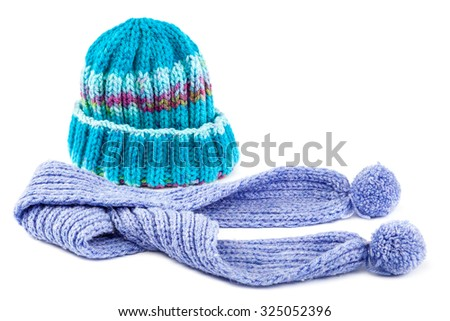 Cold winter clothing - hat or cap, scarf. - stock photo