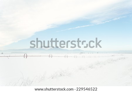 Cold winter day in north Idaho countryside. Sub-zero temperatures create a light haze and hoar frost.  - stock photo