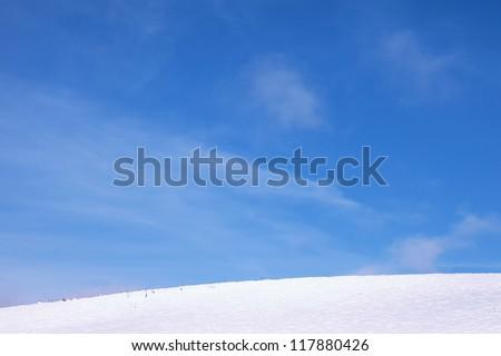 Cold winter landscape scene with blue sky. - stock photo
