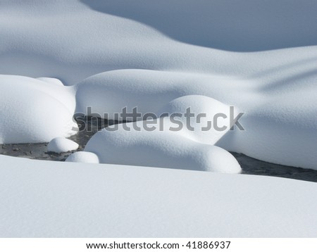 Cold winter scene with snow and water - stock photo