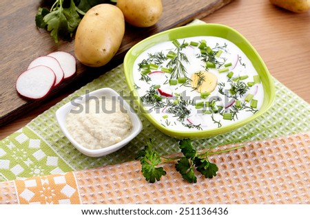Cold yogurt soup with dill and yolk, russian traditional dish - okroshka - stock photo