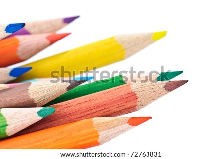 colered crayon , pencil macro shoot isolated against a white background