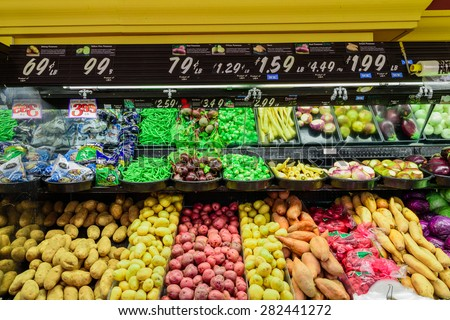 COLFAX, WA, US  MAY 22, 2015  Variety of potatoes tubers in supermarket at Colfax, Whitman County, Washington, USA; including: Raw, baking, yellow, finn, red, white, potatoes, yam, green, beans
