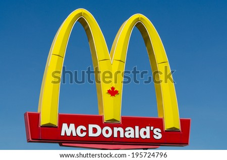COLINGWOOD, ONTARIO - MAY 28, 2014: Canadian McDonald's restaurant sign in Collingwood, Ontario. McDonald's Corporation operates over 1,400 restaurants in Canada.  - stock photo