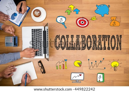 COLLABORATION Business team hands at work with financial reports and a laptop - stock photo