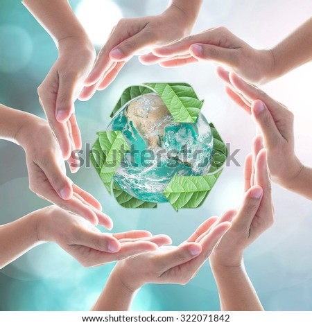 Collaborative human hands surrounding green planet protected by recycle sign leaf on blur abstract background: Recycle reduce reuse eco idea: Business CSR concept: Element of image furnished by NASA  - stock photo