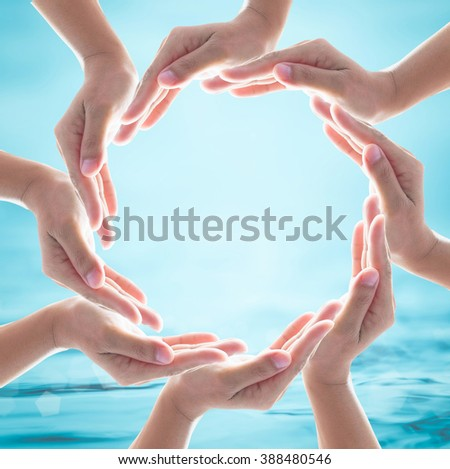 Collaborative womwn human hand group cycle symbolic sign on blur blue turquoise clean sea ocean river background: World water day design logo concept: Saving aqua csr environmental protection campaign - stock photo