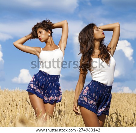 Collage, Beautiful sexy young women in blue skirt in a wheat golden field - stock photo