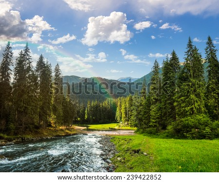 collage landscape with pine trees in mountains and a river in front flowing to lake with rainbow - stock photo