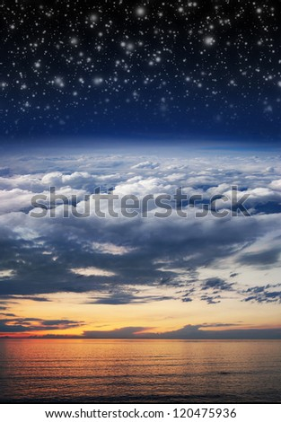 Collage: ocean, sunset, sky, clouds, stratosphere and space in one image - stock photo
